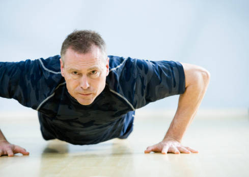 Older man doing press ups. Muscle building is for everyone, not just the young and athletic.