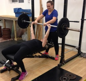 Learning the bench press in a weight training for women beginners class