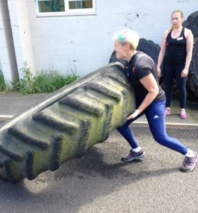 Ann flipping the 150kg tyre