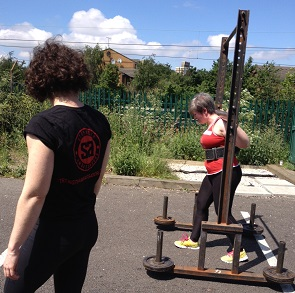 Laura tackling the yoke at strongwoman workshop
