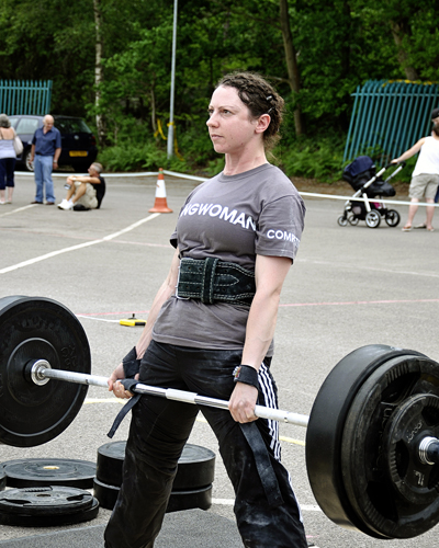 Sally deadlifting 110kg at a strongwoman competition