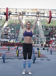 Samantha Briggs holding a big weight overhead at the Crossfit Games