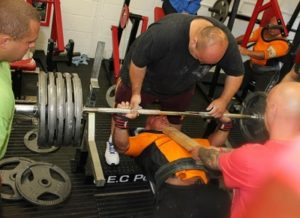 Group of powerlifters benching