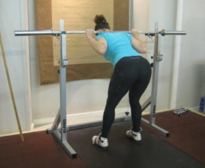 Woman doing barbell good morning