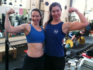 Sally and Anna bicep pose, the picture of strength and health