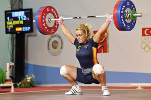 Lidia Valentin gets into a deep squat position to receive a snatch