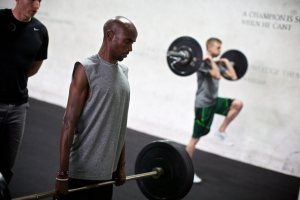 Strength training for runners - Mo Farah lifting a barbell