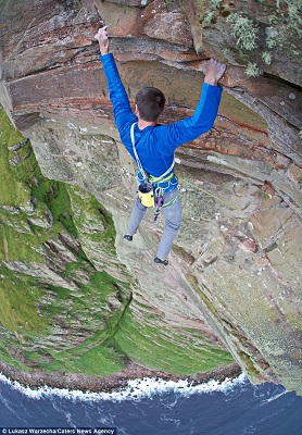 Climber Dave Macleod hanging at 1000 feet