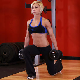 Woman doing lunges outside the squat rack