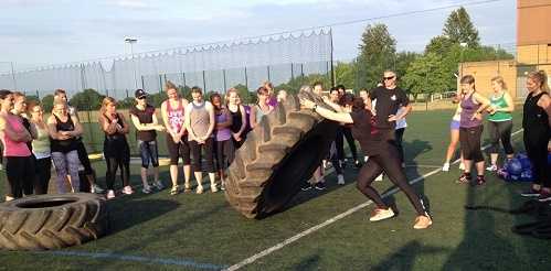 Sally demonstrating a tyre flip at a strength workshop for Barbell Girls in Brentwood, Essex