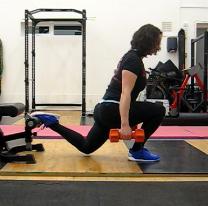 woman doing rear foot elevated split squat