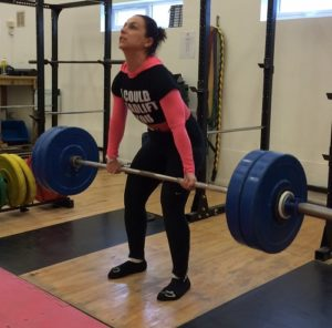 Julia strength training in a powerlifting team session