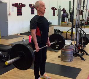 Ken deadlifting in a strength ambassadors class