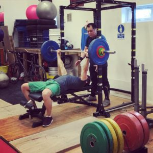 Training buddies benching at Strength Ambassadors