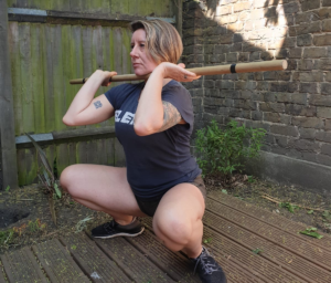 Olympic Weightlifting with a stick in the garden