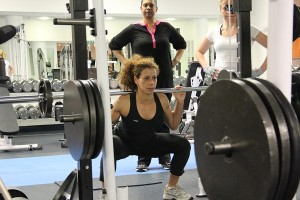 Mastering the squat in a strength training technique workshop