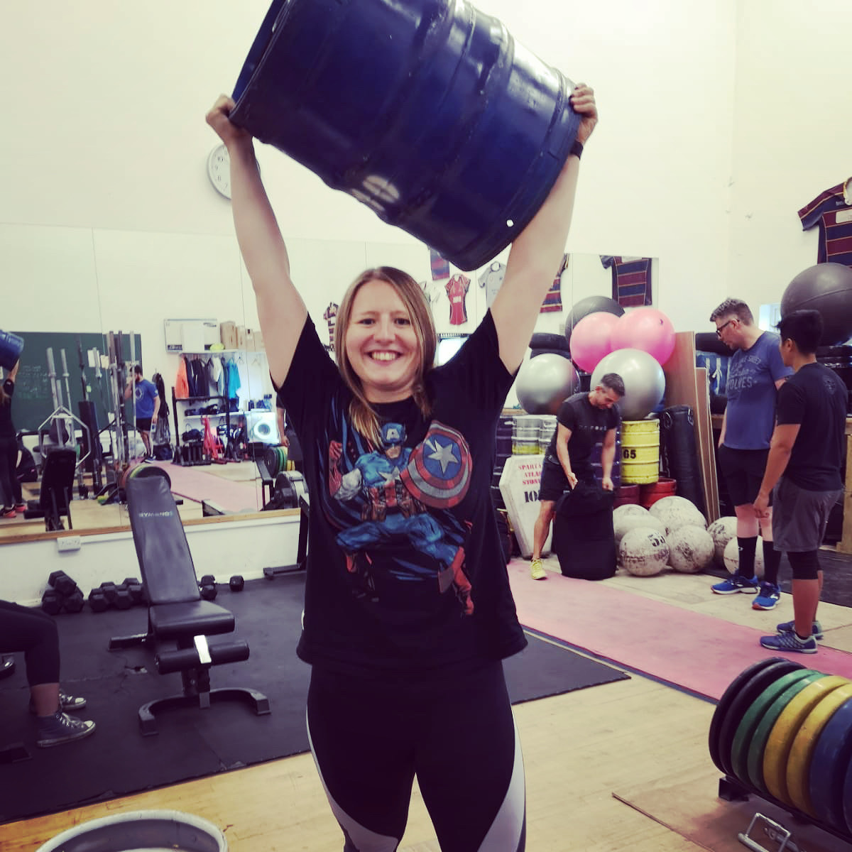 women lifting keg